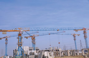 Explaining why tower cranes are becoming increasingly important in precast building constructions